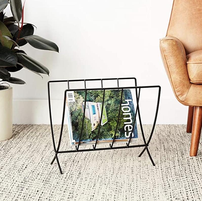 Photo of magazine holder on floor in room