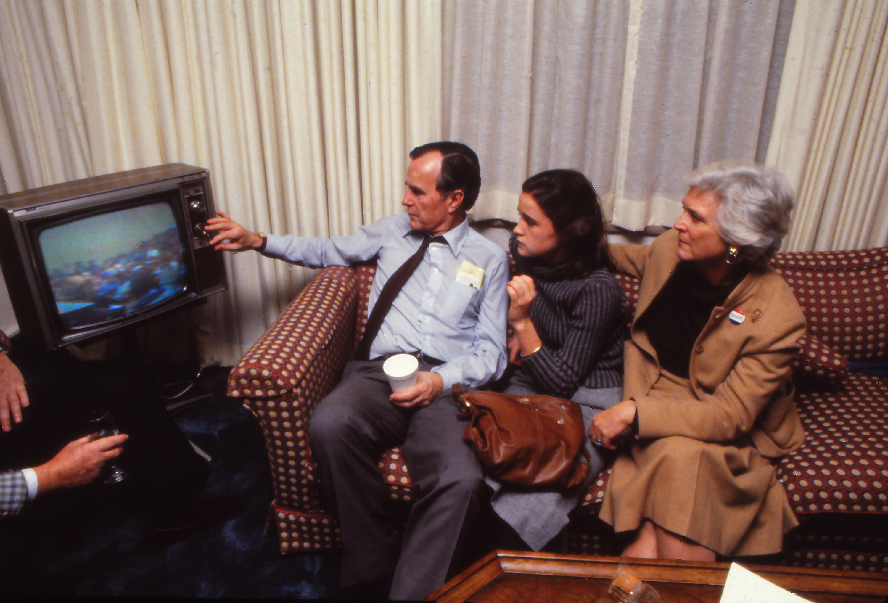 George Bush and family watching television