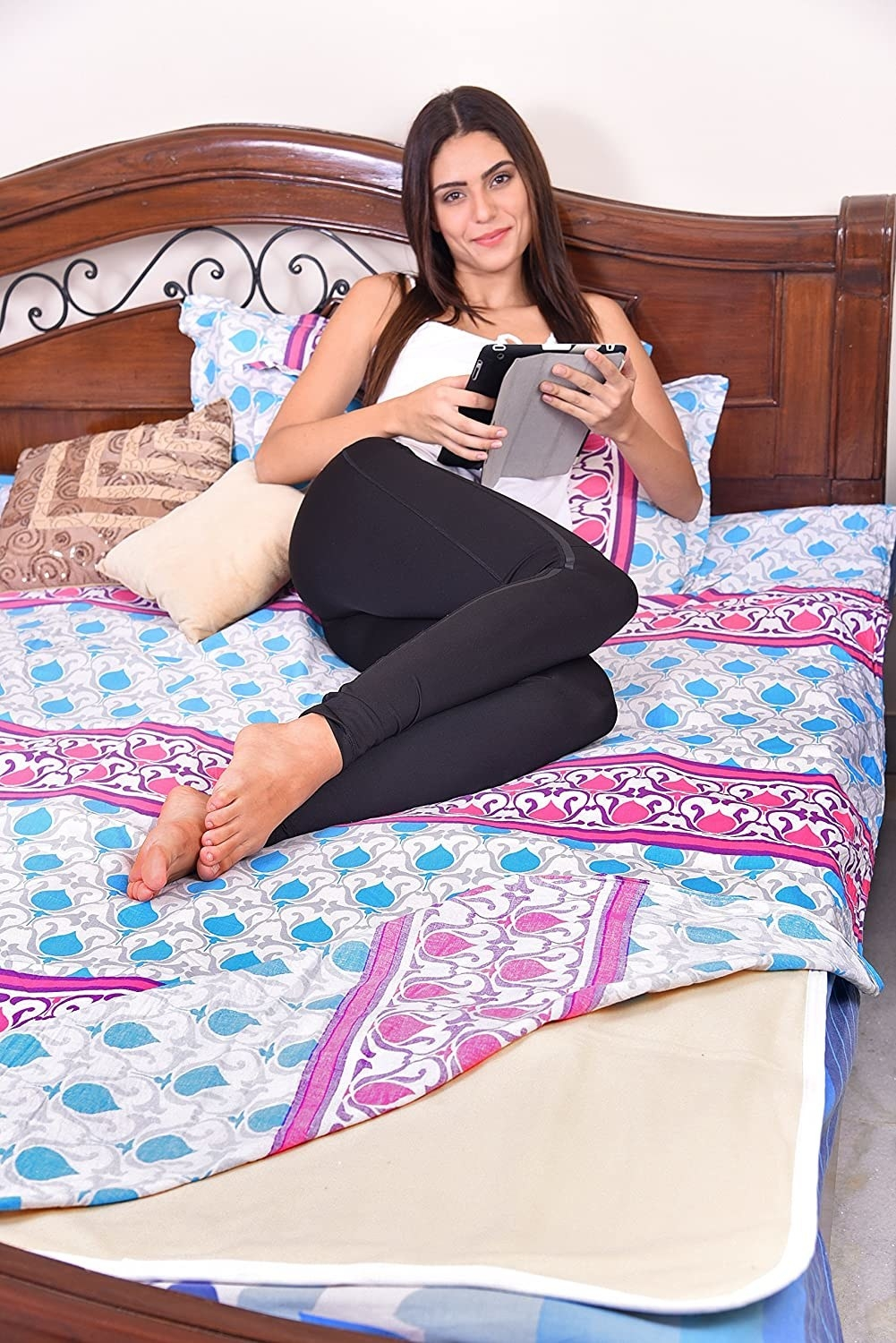 A woman using the bed warmer.