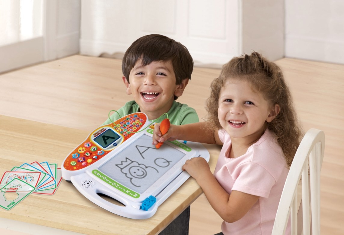 The writing toy being used by two preschoolers