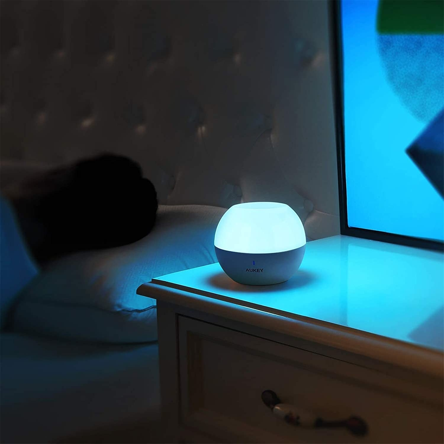 A person sleeping next to the night light