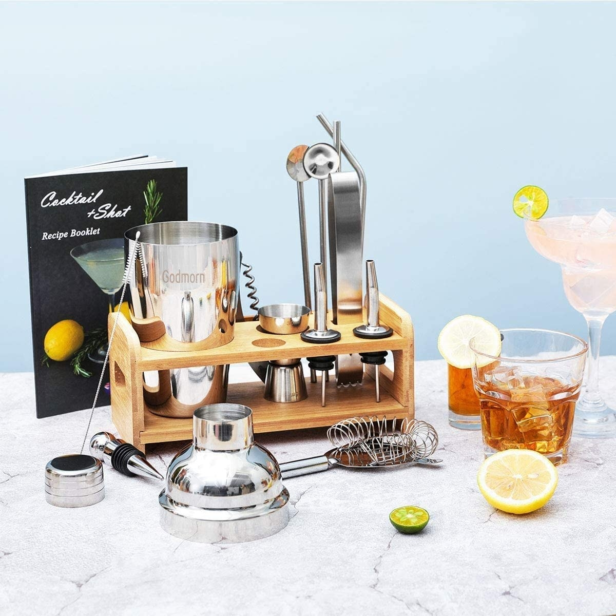 The bartending kit, stand, and several mixed drinks