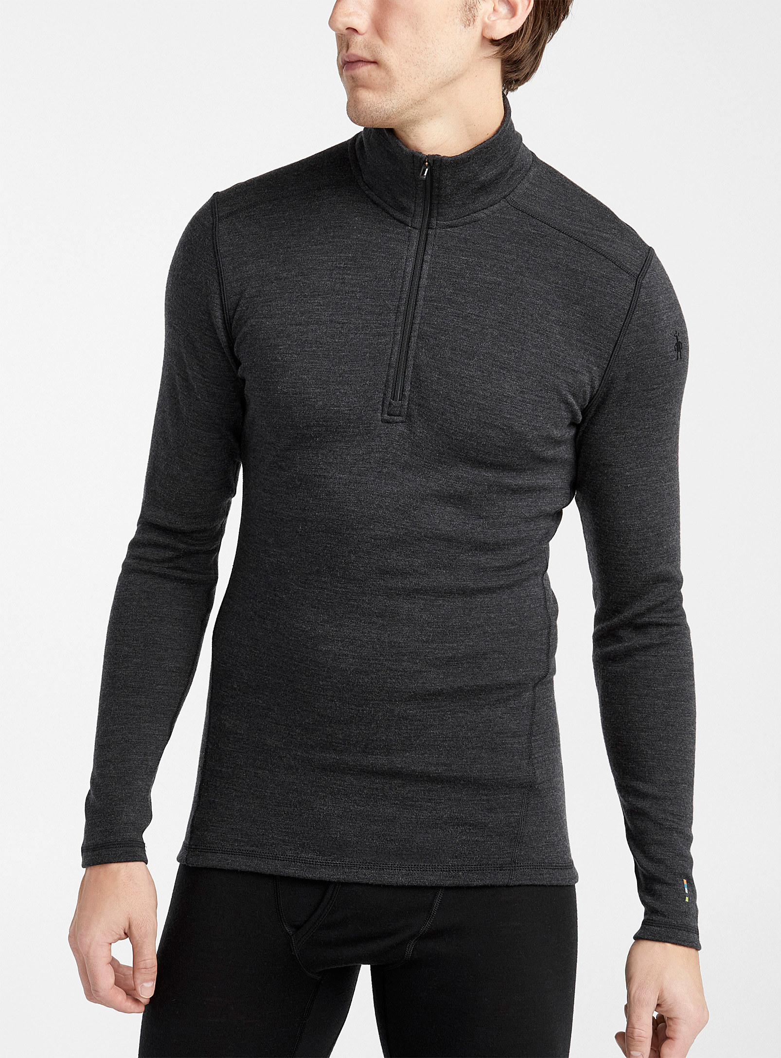 A person wearing a long sleeved thermal shirt