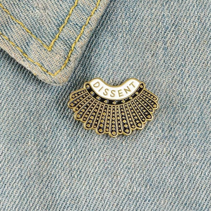 The pin next to the lapel on a jean jacket