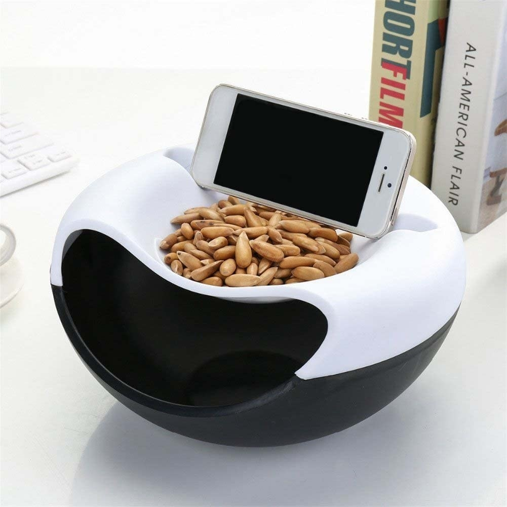 The bowl with seeds and a phone on top of it
