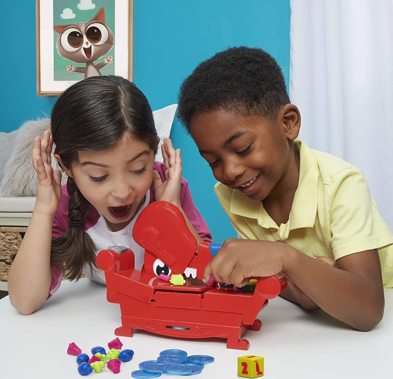 Two child models playing with red plastic couch game