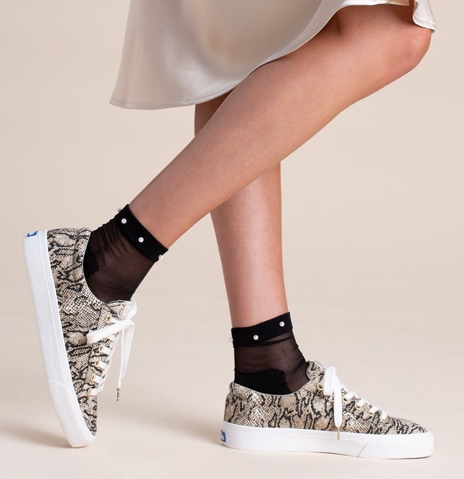 A person wearing the Keds with mesh socks