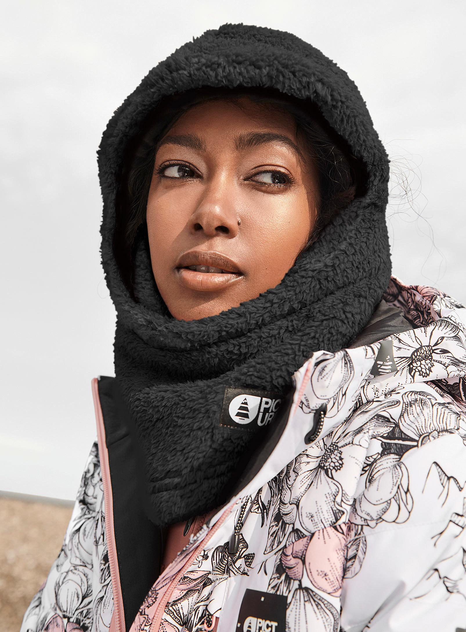 A person wearing a fleece balaclava and winter coat