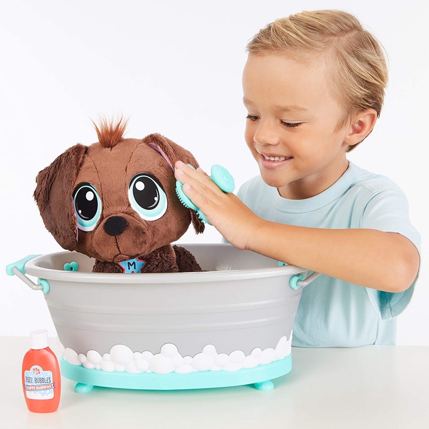 Child model playing with stuffed toy dog in the bathtub