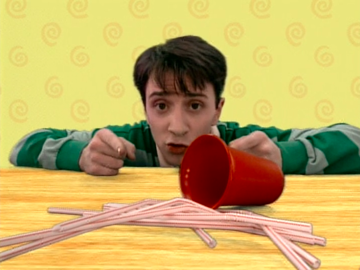 Steve in front of a bunch of straws on a table