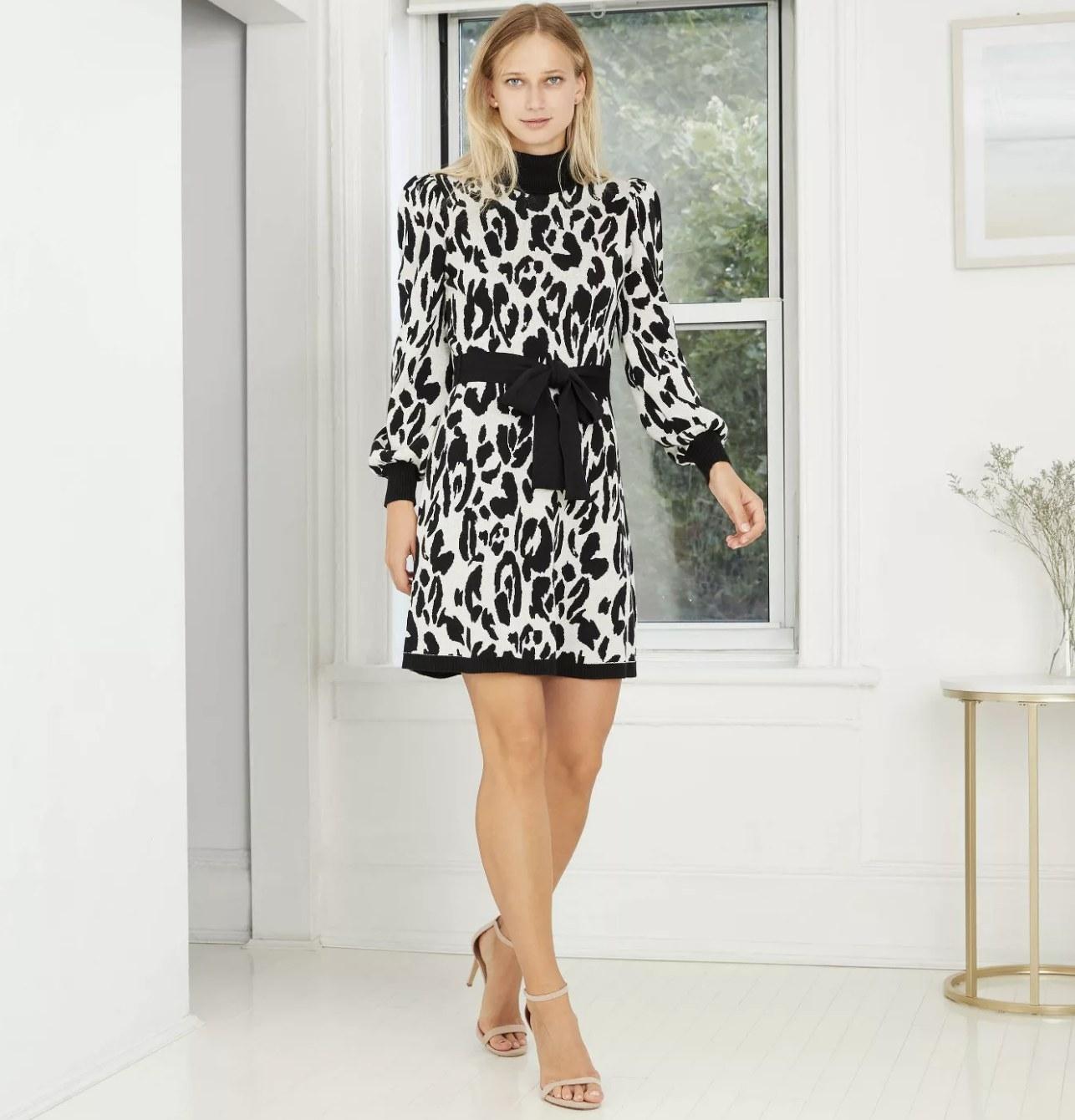 zebra print sweater-dress with black belt