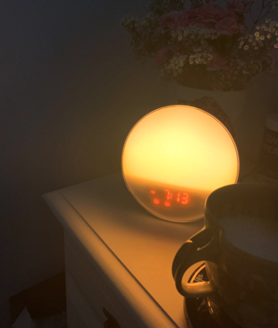 reviewer image showing light alarm clock in a dark room