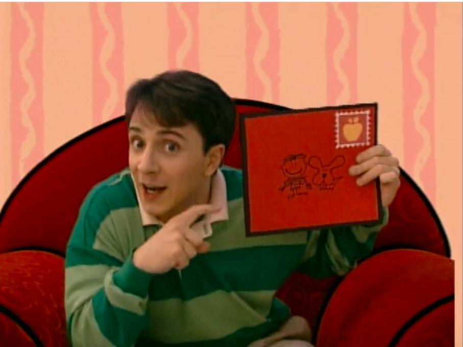 Steve holding a letter