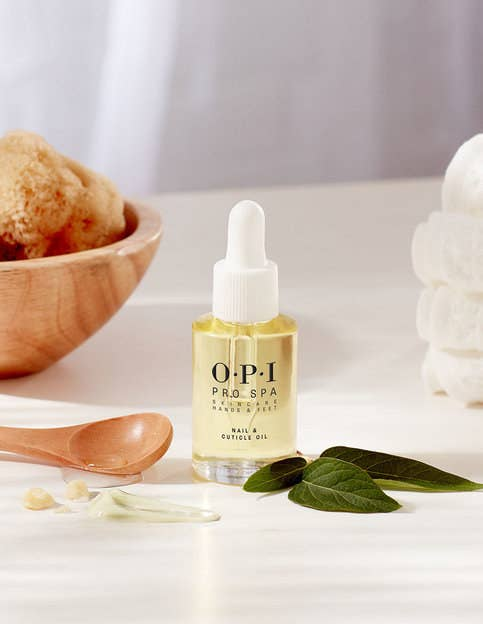 bottle of cuticle oil surrounded by ingredients