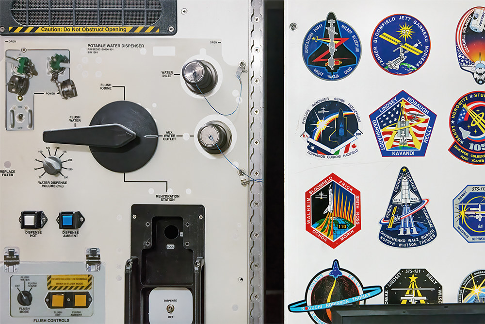 A door with a water dispenser covered in patches