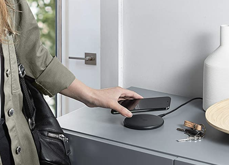 Model placing iPhone on the Anker wireless charger