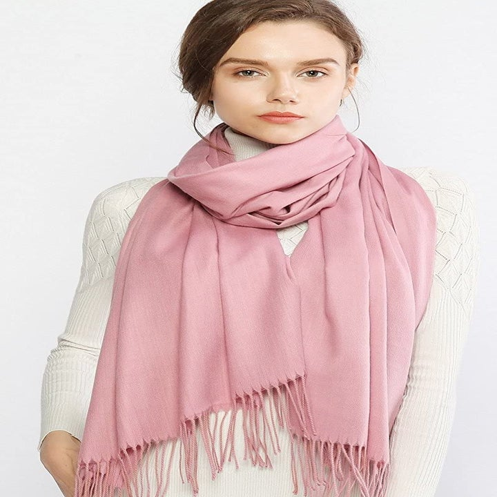 Model wearing scarf around neck
