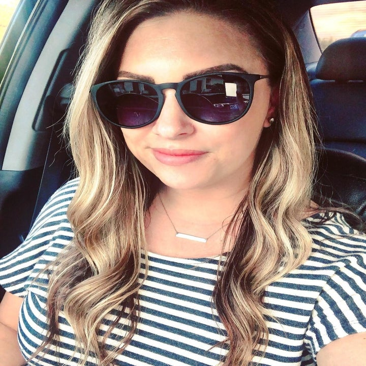 Reviewer wearing sunglasses with black matte