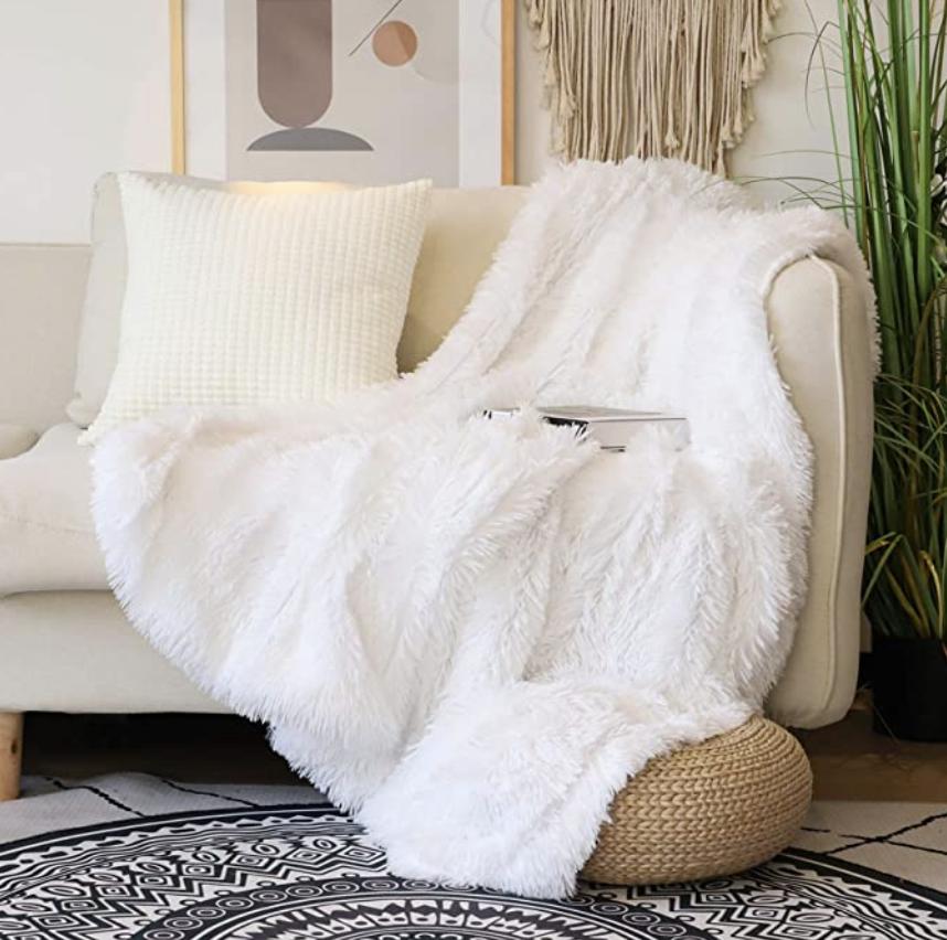 Photo of white faux fur throw on sofa