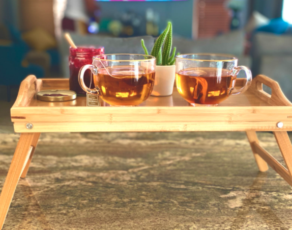 reviewer photo showing wooden tray with two cups of tea on it
