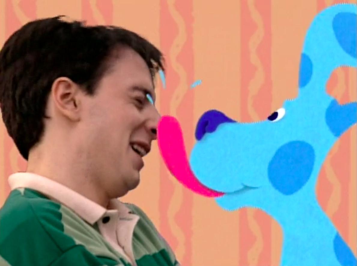 Blue licking Steve's face