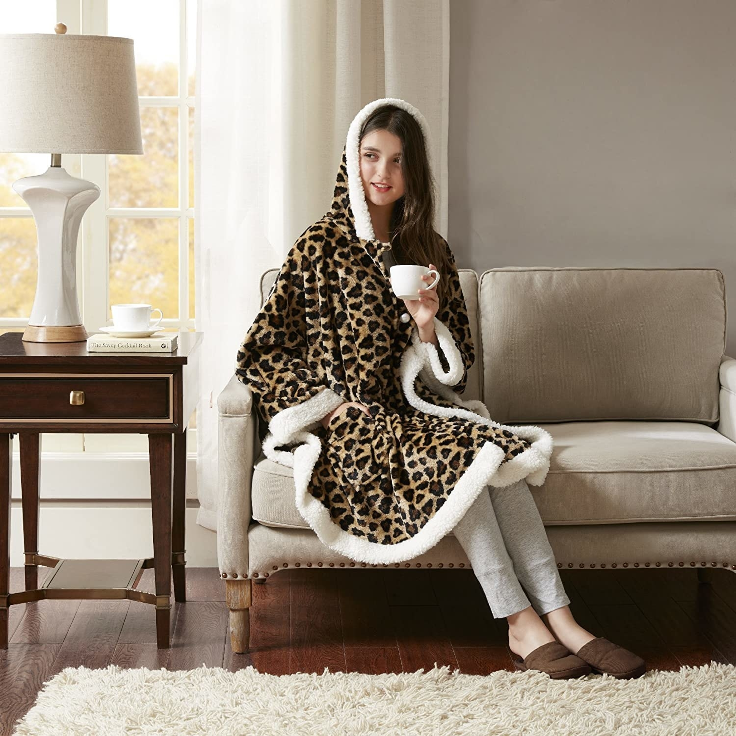 a model wearing the sherpa blanket in leopard print