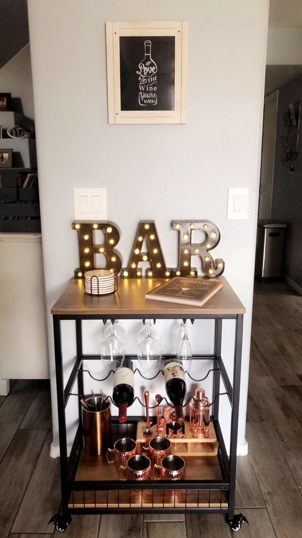 Reviewer photo of stocked bar cart in home