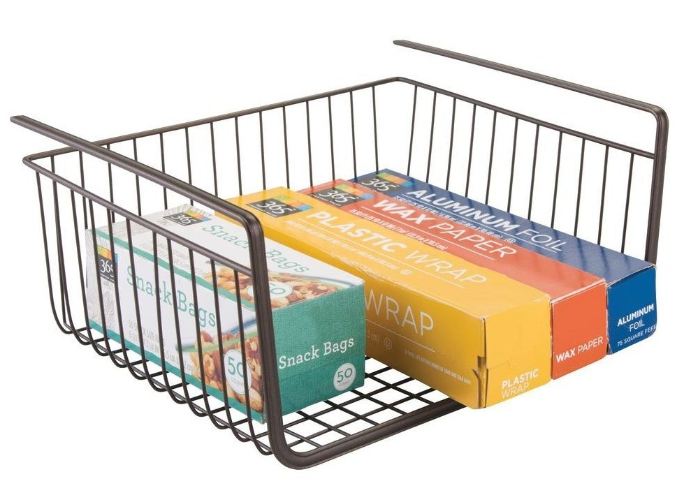 Bronze under-the-shelf basket carrying plastic wrap containers and snack baggies