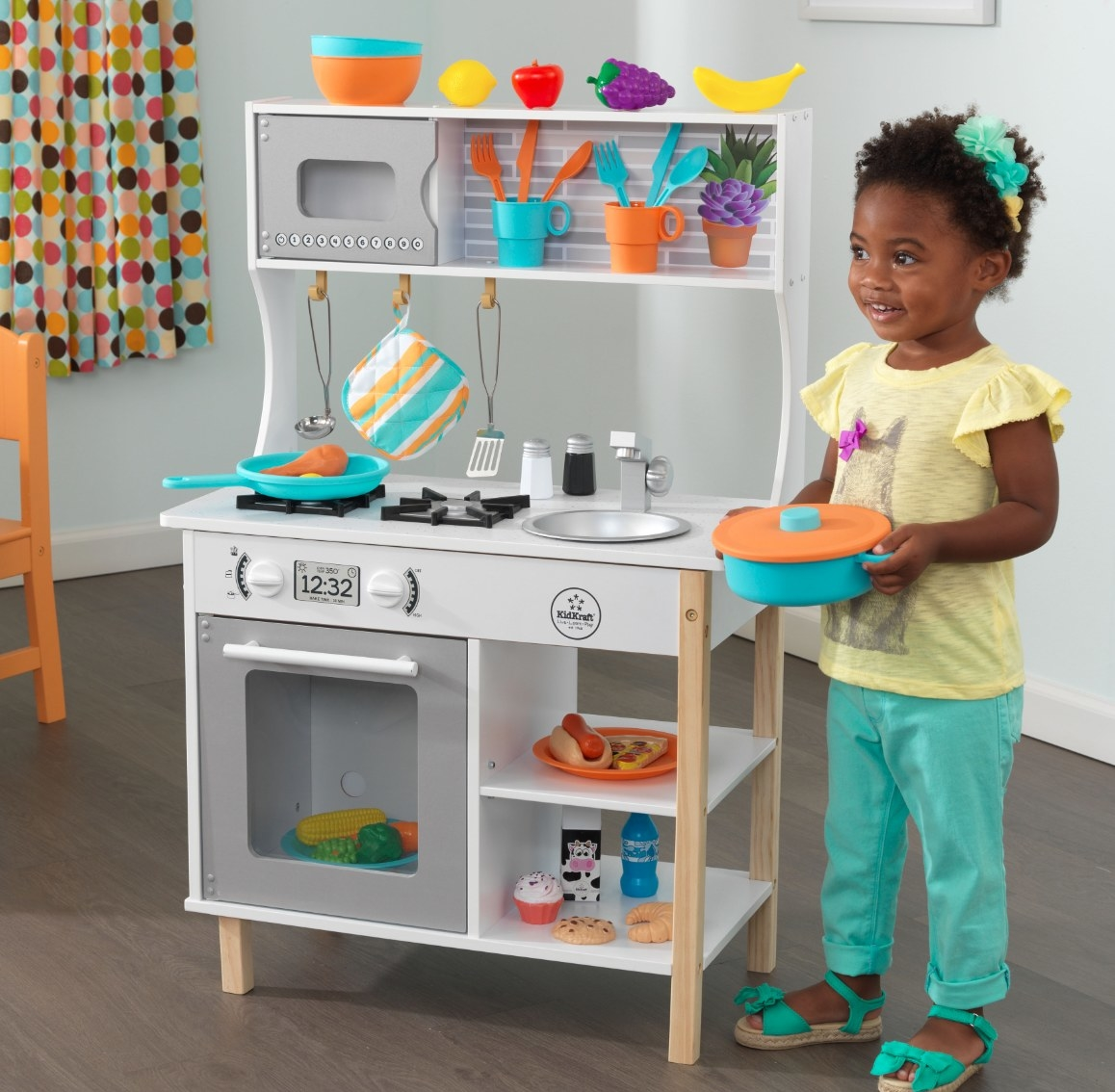 The 38 piece kitchen accessory playset with a white stove and counter