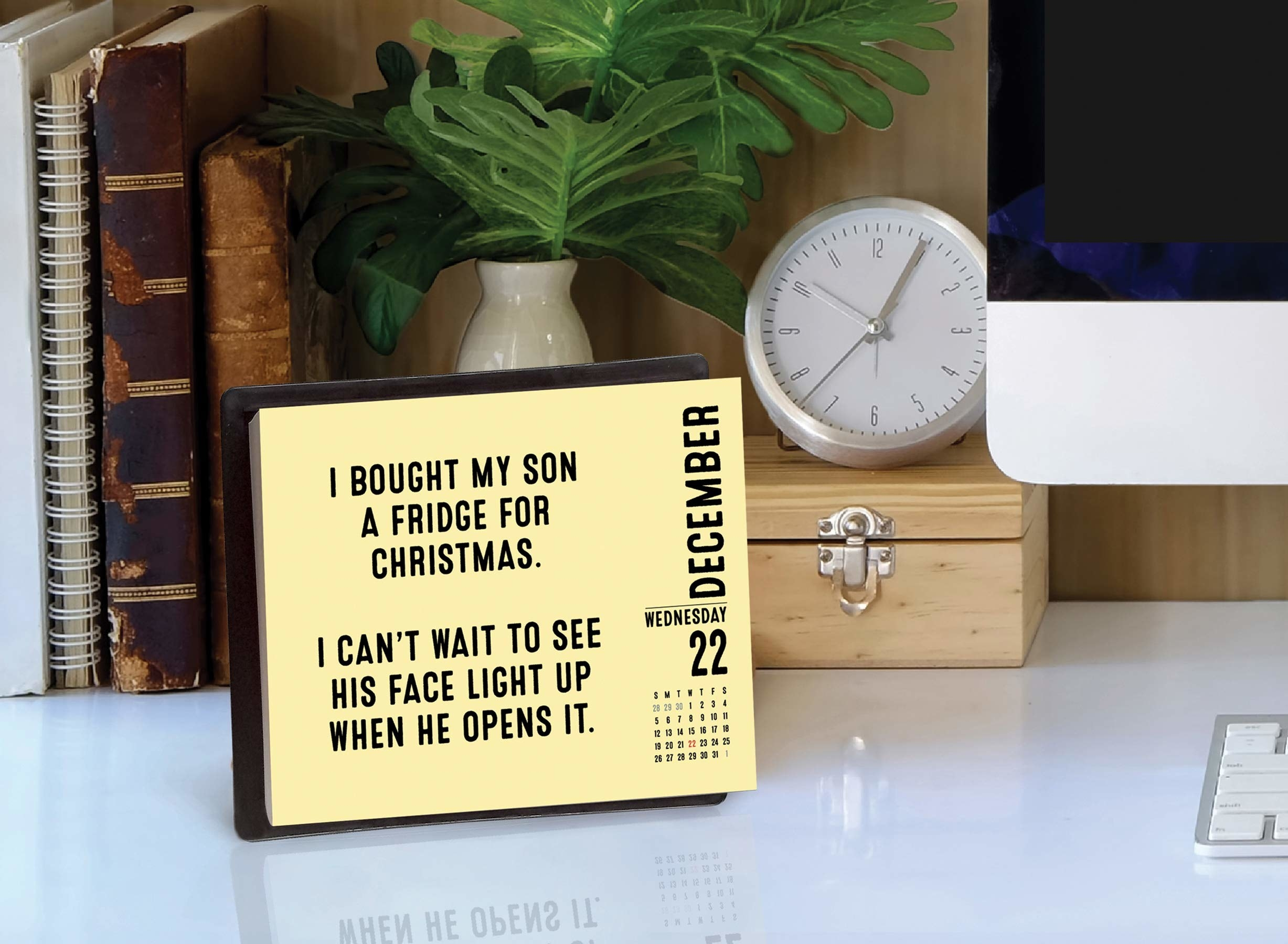 """desk calendar that says """"i bought my son a fridge for christmas. i can't wait to see his face light up when he opens it"""""""