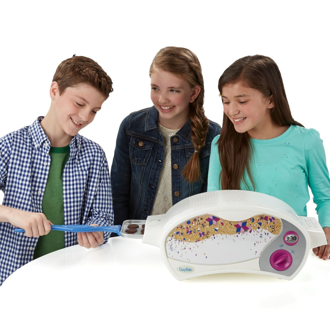 The easy-bake ultimate oven in white with cookies going inside it