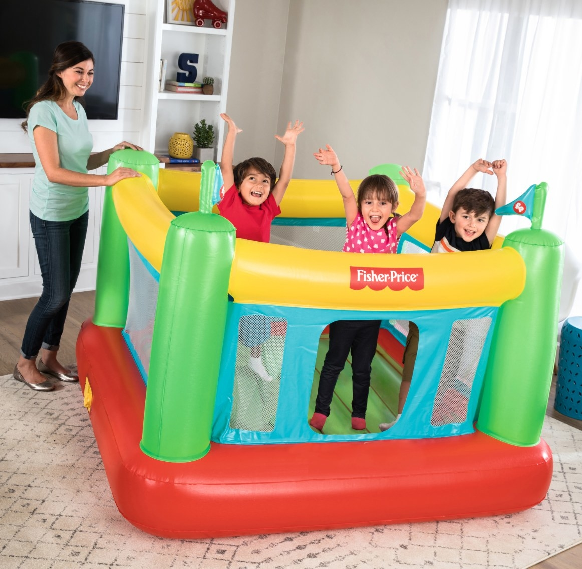The bouncy house in yellow, green, blue, and red