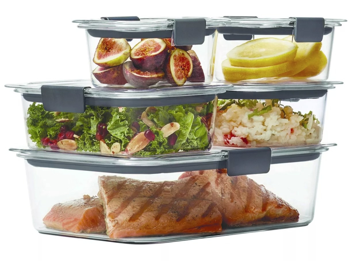 A set of five clear food containers with gray latches