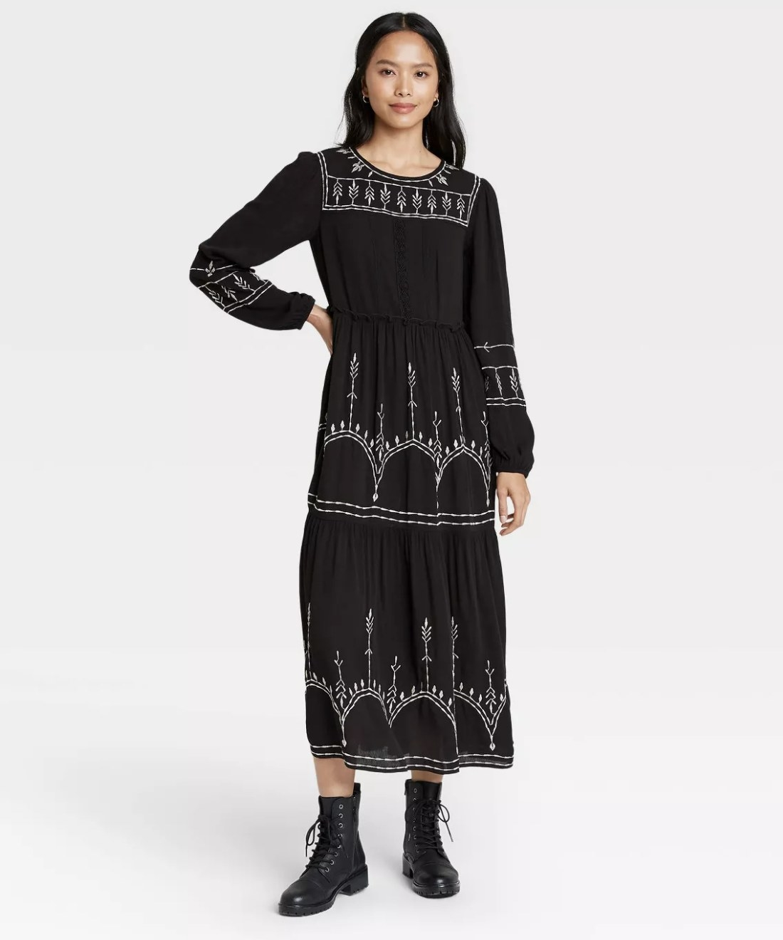 black long-sleeve maxi dress with white embroidery
