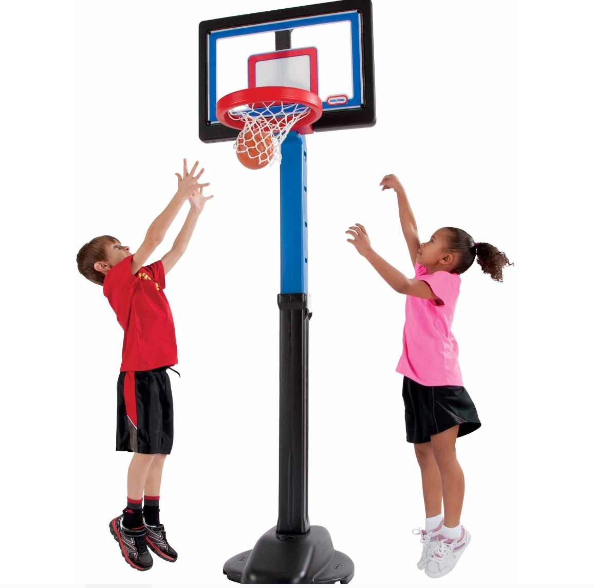 The basketball set being used by a boy and girl