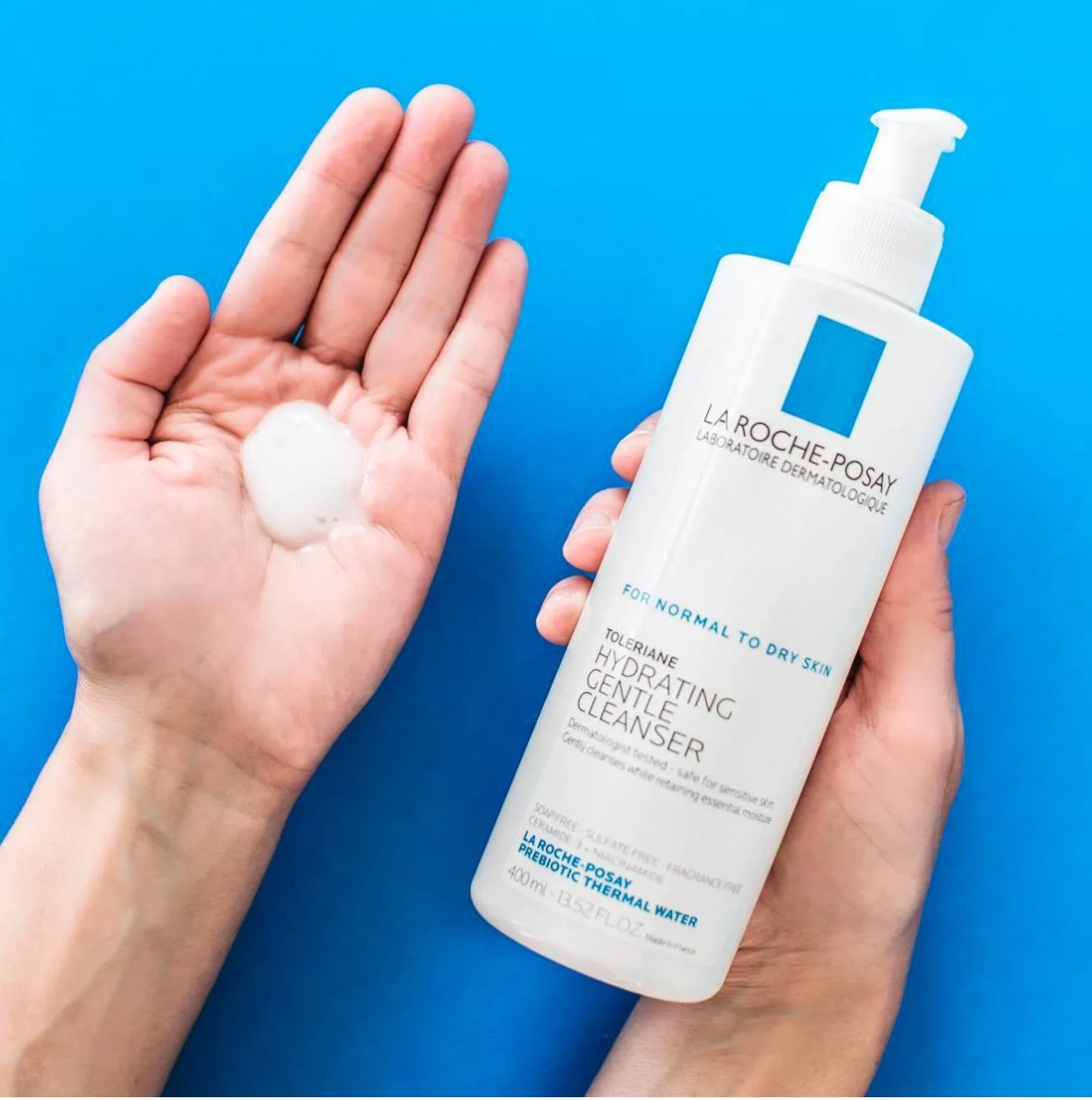 Hands pumping the milky-like cleanser