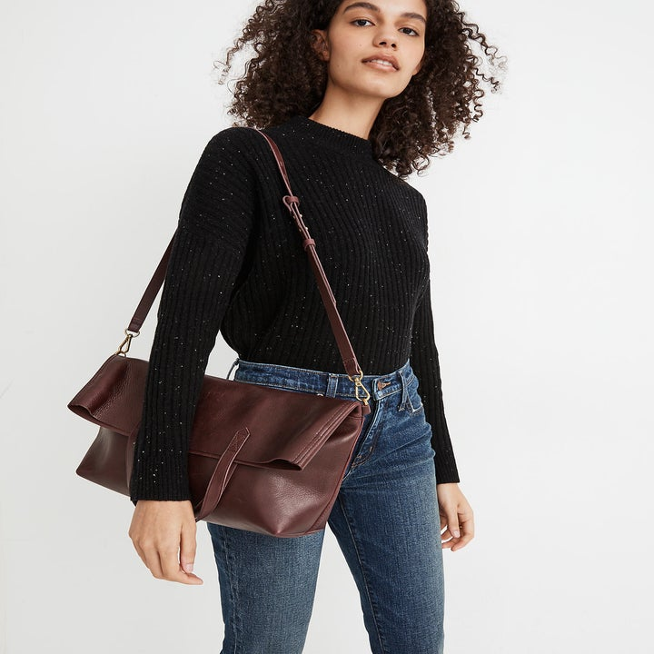 model carrying the dark red purse
