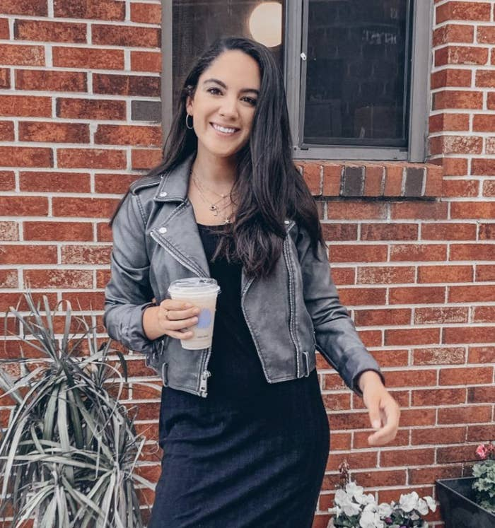 reviewer wearing the charcoal grey faux suede jacket