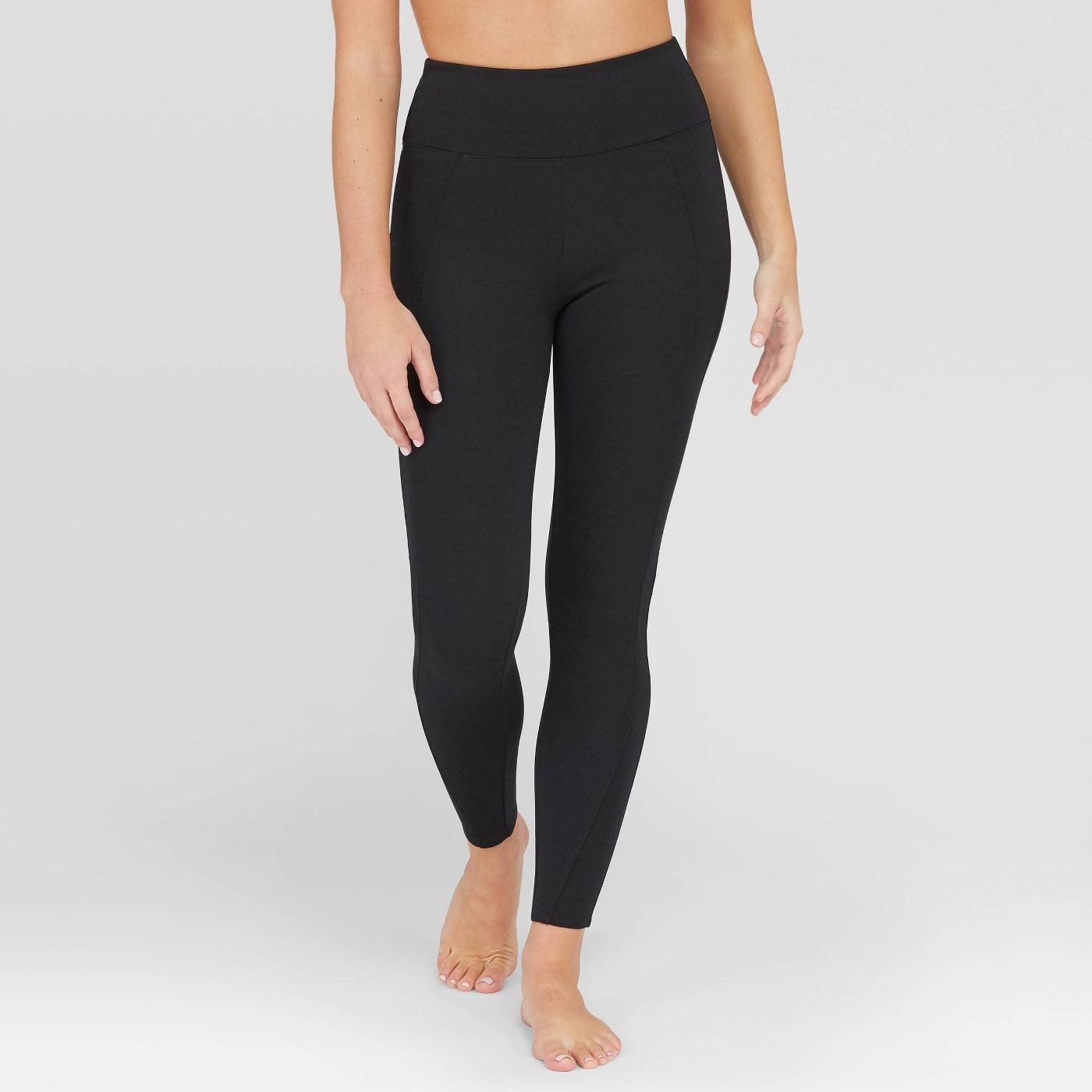 Model in black shaping leggings