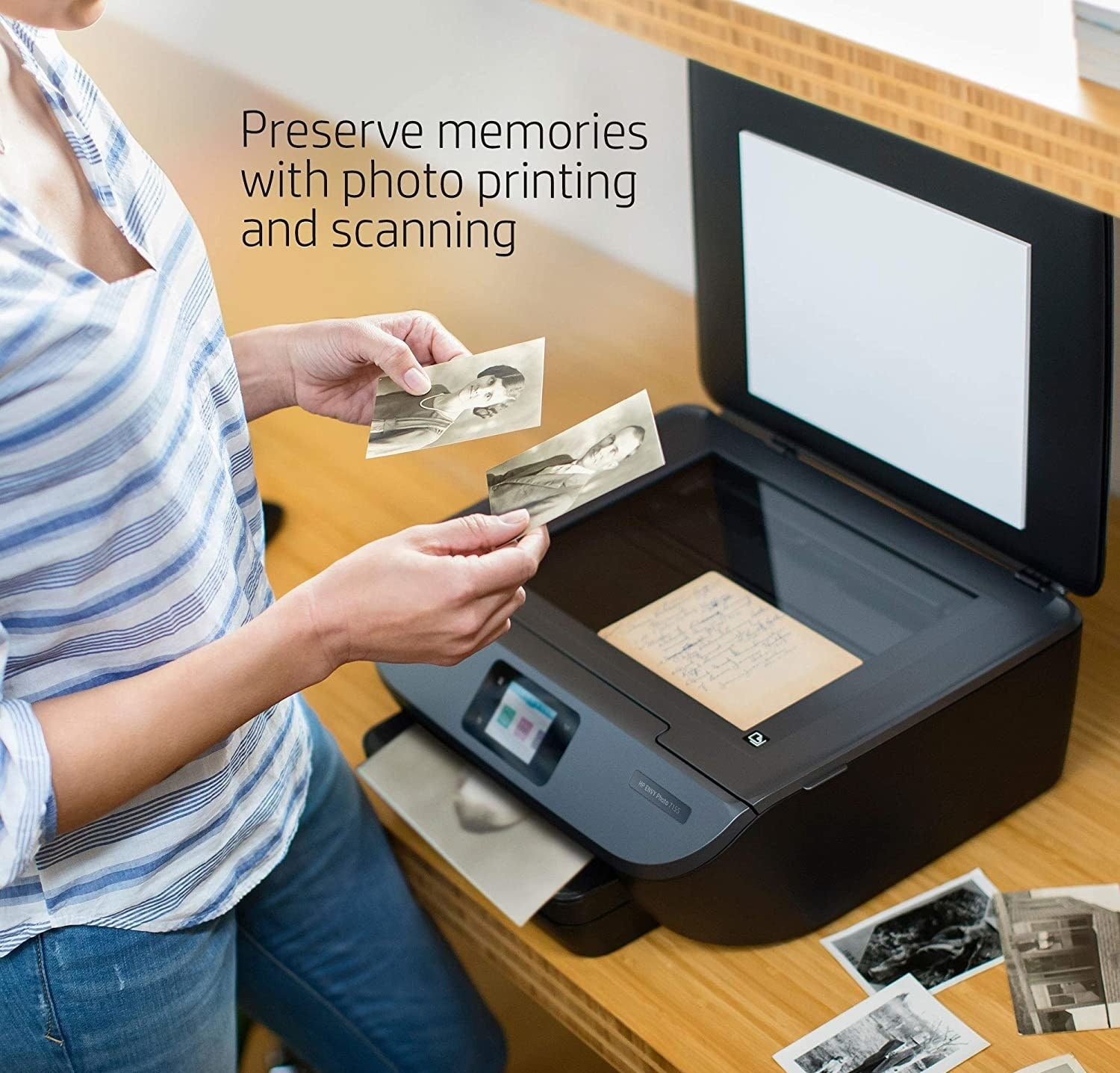person scanning old family photos on the printer
