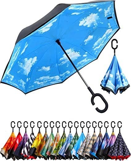 the umbrella with a cloud sky pattern on the inside of the umbrella