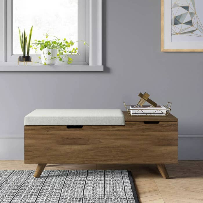 The cushioned wooden bench with opening for storage