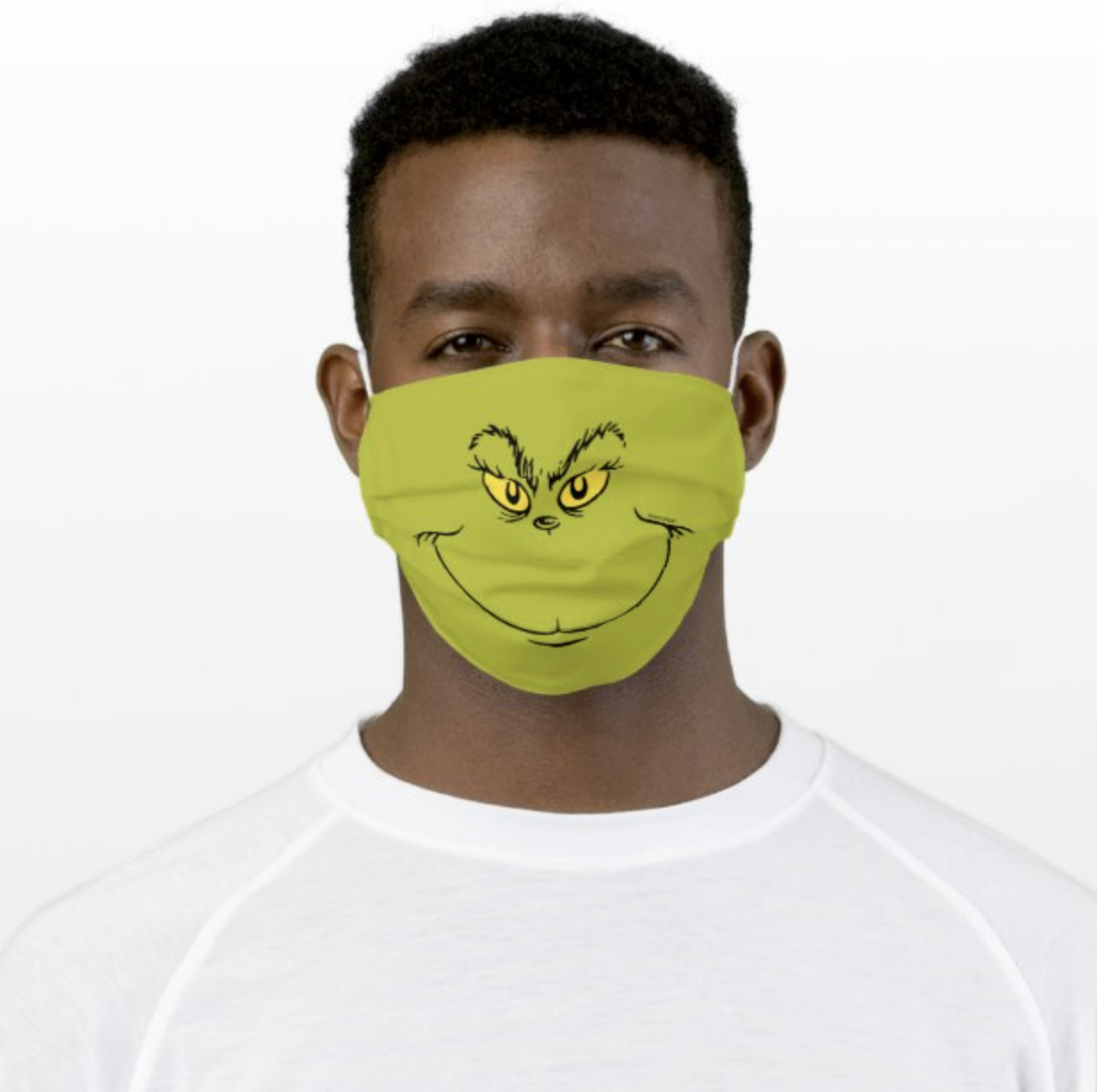 Model wearing face mask featuring the Grinch's face