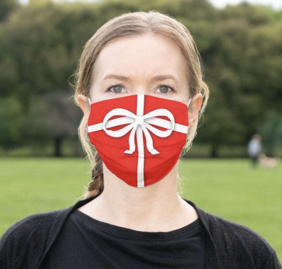 Model wearing red face mask that looks like a gift-wrapped present