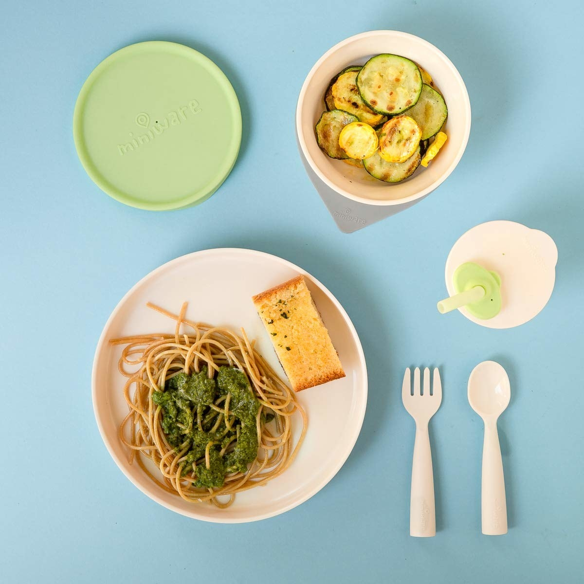 Child's dining set including two plates, a bowl, fork, spoon, and bottle with straw