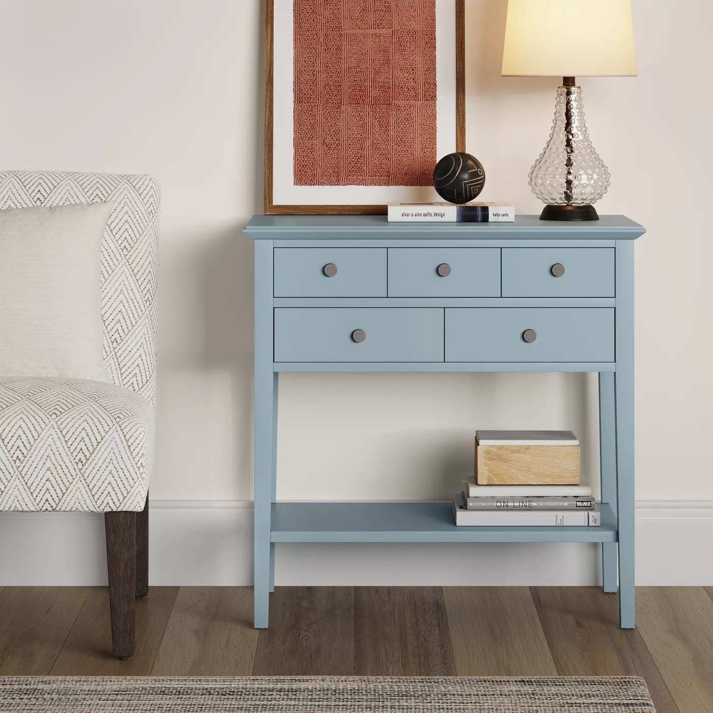 The small light blue end table with five drawers