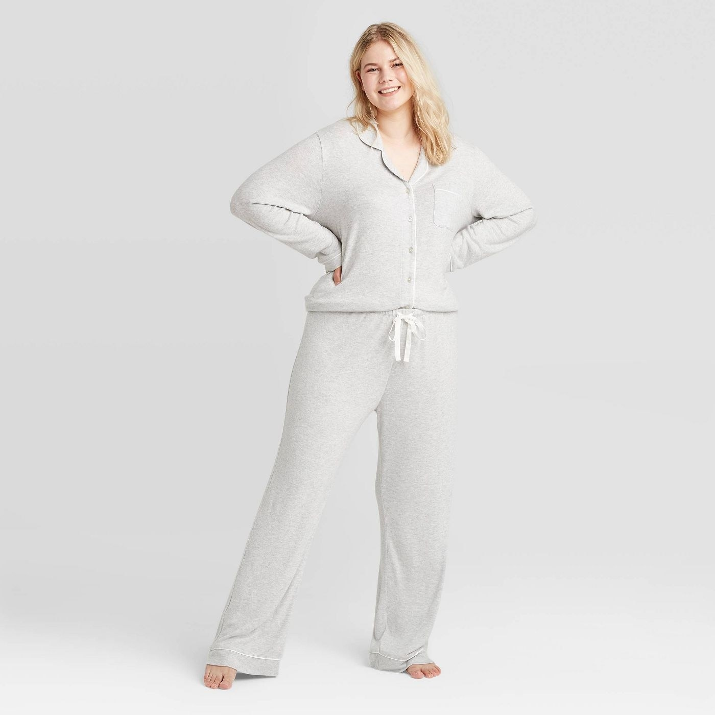 Model in gray long sleeve pajama set
