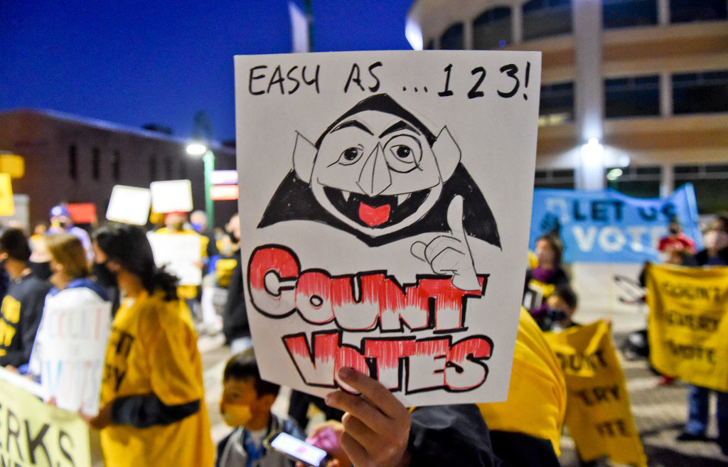 A count from sesame street sign that says count the vote