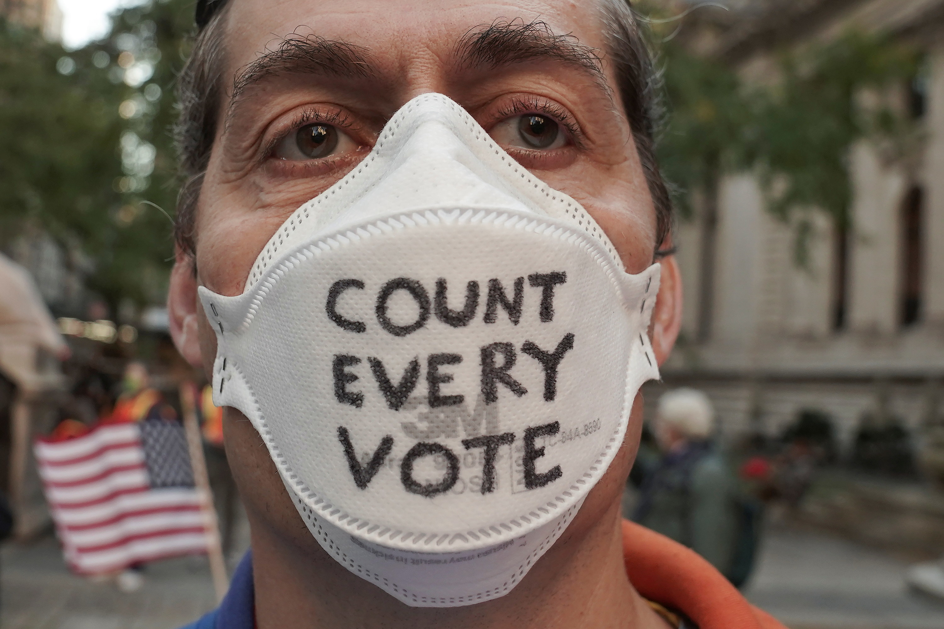 A person with a count every vote mask