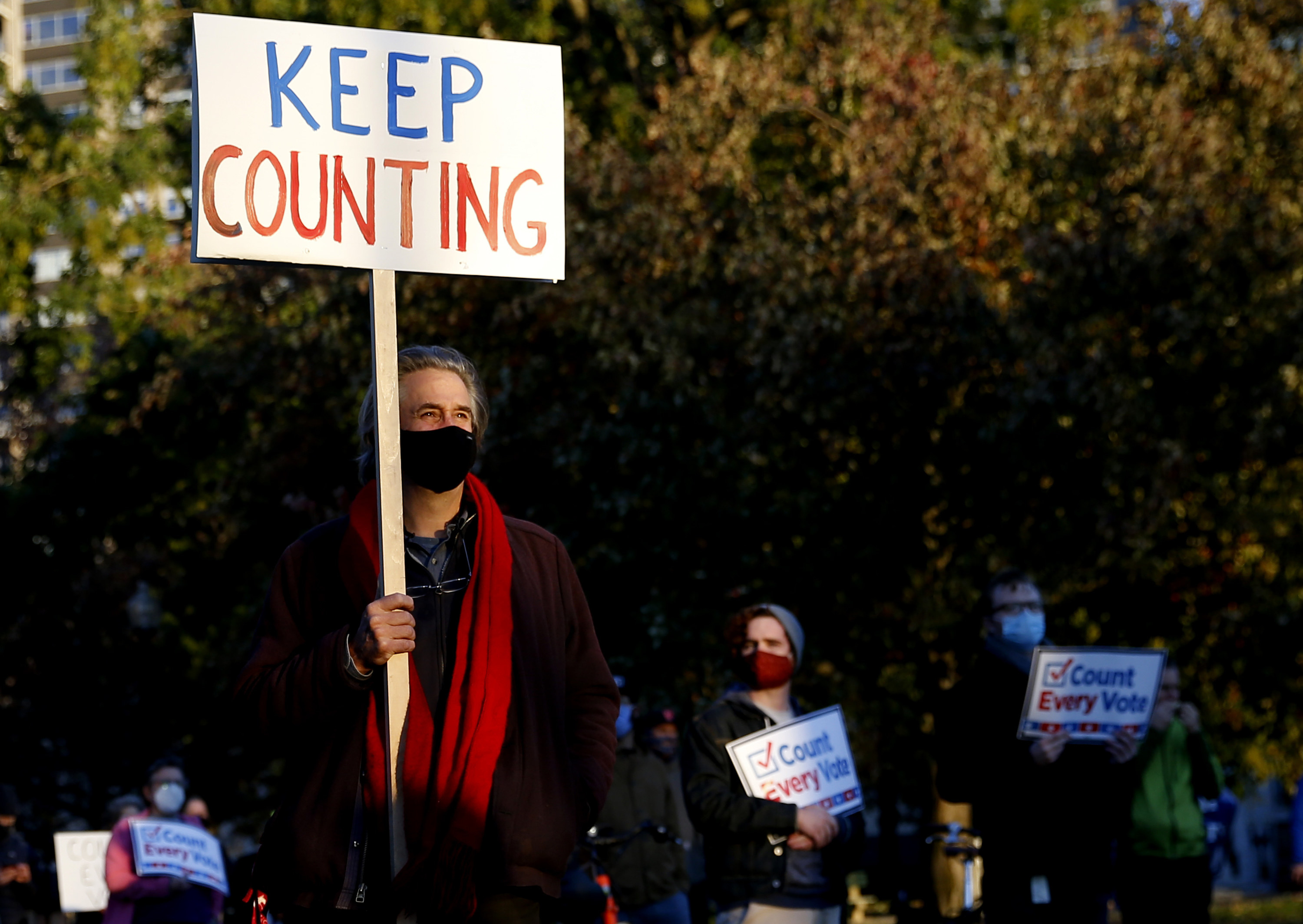 A person holding a keep counting sign